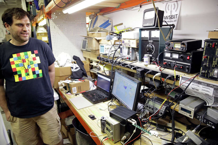 Jeremy Zunker looks over his collection of electronic gear at 10BitWorks on May 5, 2015. Photo: Photos By Tom Reel / San Antonio Express-News