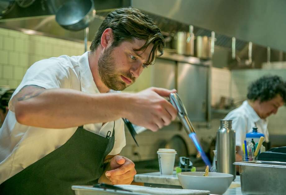 Chef/Owner Michael Mauschbaugh uses a torch on the Chocolate-Buttermilk Glacee at Sous Beurre Kitchen. Photo: John Storey, Special To The Chronicle