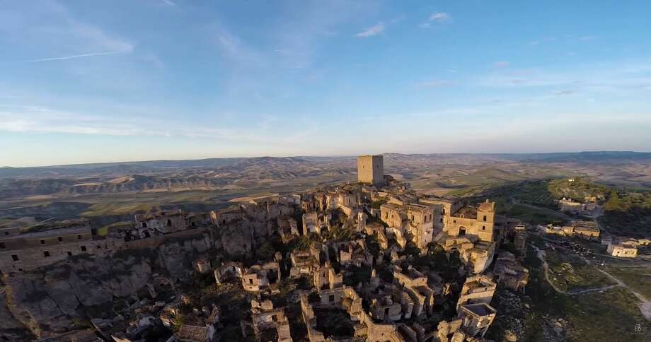 DRONE PHOTOS CAPTURE HAUNTING GHOST TOWNS AROUND THE WORLDBe On My Mind captured video of Craco, an Italian ghost town abandoned in the 1960s after a series of natural disasters.(Video: Be On My Mind) Photo: Screenshot Via YouTube