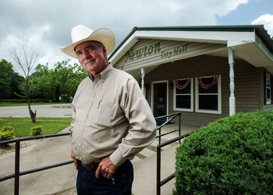 Billy Rowles poses for a photo outside Newton City Hall on Wednesday. Rowles, who gained national attention as the sheriff of Jasper during the investigation of James Byrd, Jr.'s murder, is wrapping up a stint as the interim police chief of Newton, Texas.