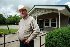 Billy Rowles poses for a photo outside Newton City Hall on Wednesday. Rowles, who gained national attention as the sheriff of Jasper during the investigation of James Byrd, Jr.'s murder, is wrapping up a stint as the interim police chief of Newton, Texas.  Photo taken Wednesday 5/6/15  Jake Daniels/The Enterprise