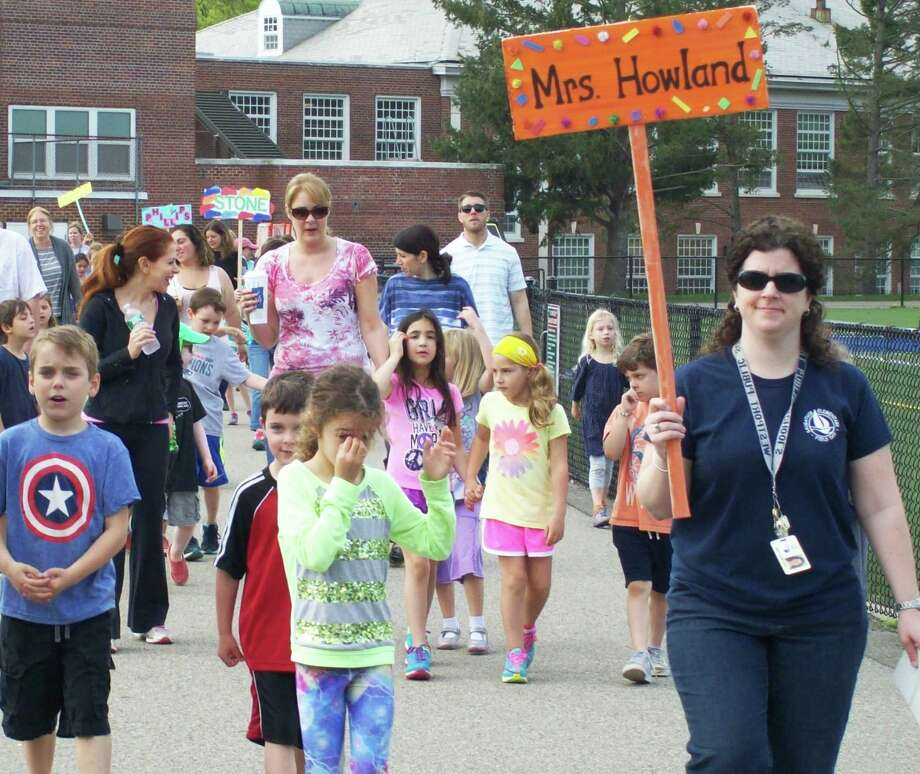 """Students at Saugatuck Elementary School began their """"walk"""" to Saugatuck, Michigan, Monday. The fundraising event will benefit the Hole in the Wall Gang Camp. Photo: Anne M. Amato / westport news"""