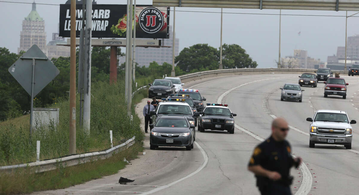 San Antonio police investigate a scene on the side of IH-37 near IH-10 where a deceased small baby was found inside of a piece of luggage about 10:30 a.m. Monday May 11, 2015.. Police spokesman Javier Salazar said a worker who was about to mow the area did an inspection of the area before mowing and opened the piece of luggage and contacted police.