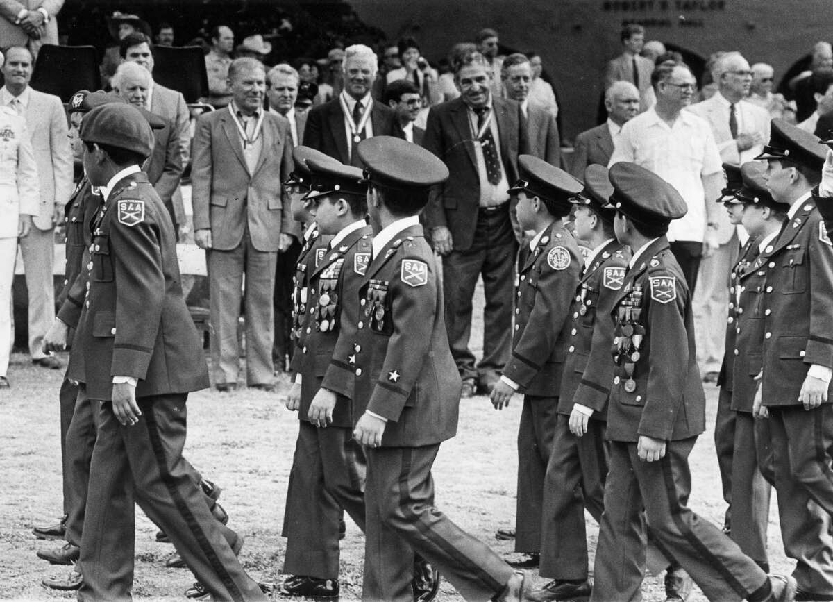 The class of 1936 surveys the SAA graduation parade 50 years later (1986).