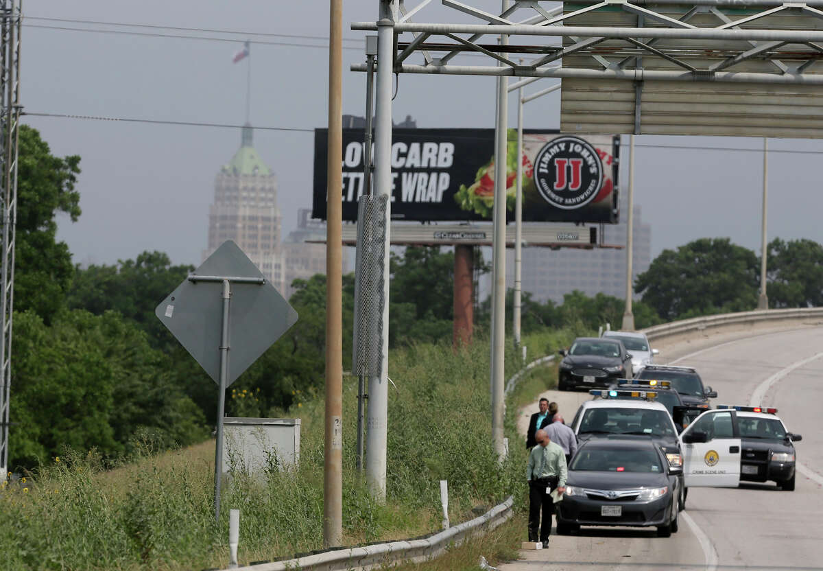 San Antonio police investigate a scene on the side of IH-37 near IH-10 where a deceased small baby was found inside of a piece of luggage about 10:30 a.m. Monday May 11, 2015. Police spokesman Javier Salazar said a worker who was about to mow the area did an inspection before mowing and opened the piece of luggage and contacted police.