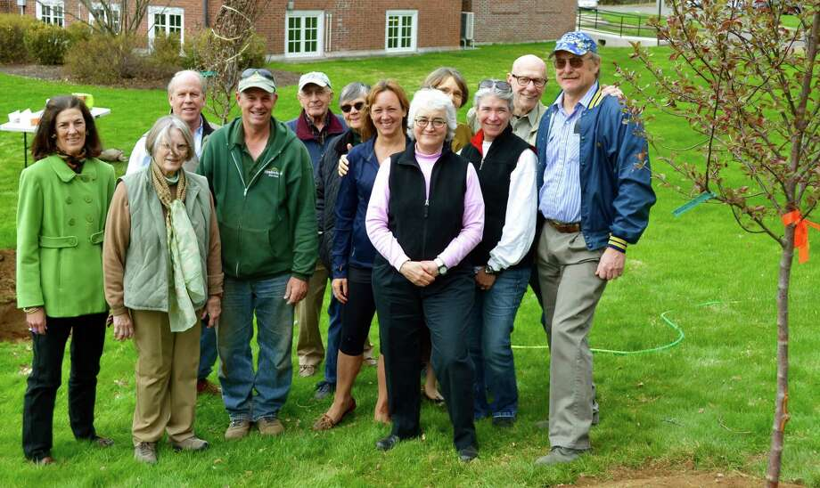 Posing for posterity on the occasion of tree plantings in Washington are, from left to right, in front, Gretchen Farmer, Gay Canal, Jeffery Stevens of Meadowbrook Gardens, Louise van Tartwijk, Sarah Jenkins, president of the Washington Garden Club, Denise Arturi and First Selectman Mark Lyon, and, in back, Nicholas Solley, selectman Tony Bedini, Betsy Manning, Cheryl Anderson and Dan Sherr. May 2015  Courtesy of the Washington  Garden Club Photo: Contributed Photo / The News-Times Contributed