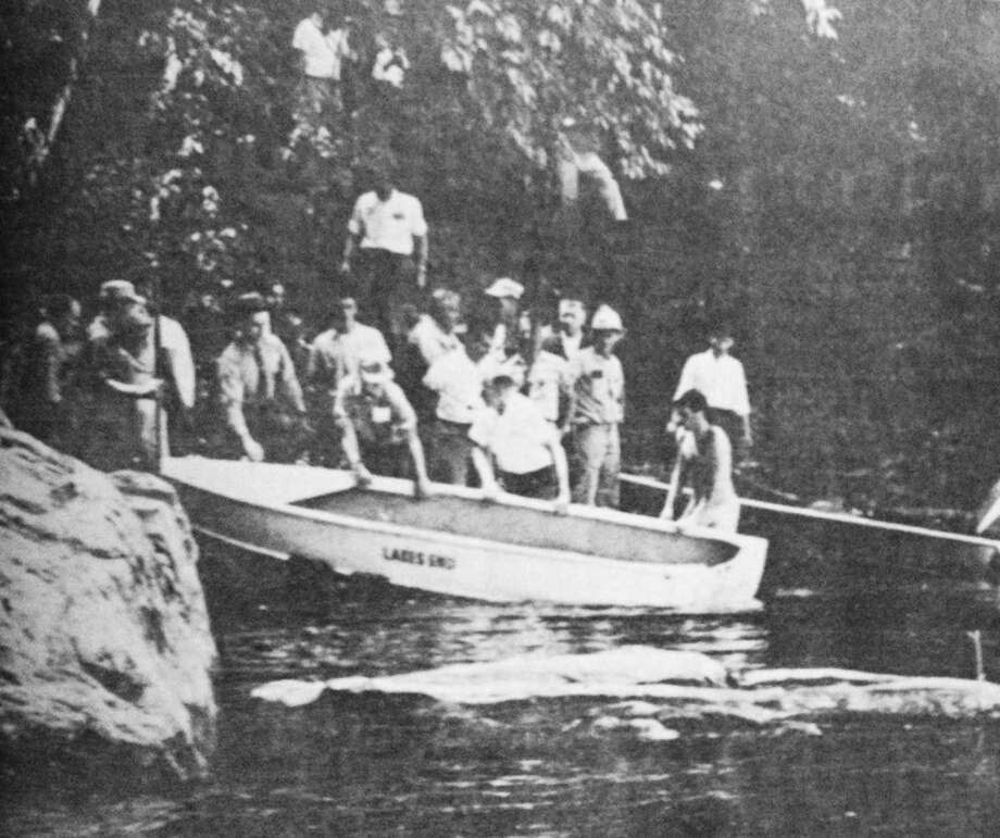 The unsuccessful rescue scene along the Housatonic River is shown in this June 1964 photograph published in the New Milford Times. New Milford police officer Kenneth Couch died in the line of duty June 3, 1964. Photo: Contributed Photo / The News-Times Contributed