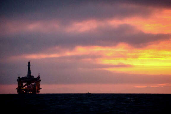 FILE - In this April 17, 2015 file photo, an oil drilling rig arrives aboard a transport ship at sunrise, following a journey across the Pacific in Port Angeles, Wash. Royal Dutch Shell hopes to use the rig for exploratory drilling during the summer open-water season in the Chukchi Sea off Alaska's northwest coast, if it can get the permits. Royal Dutch Shell cleared a major hurdle Monday, May 11, 2015, when The Bureau of Ocean Energy Management approved Shell's exploration plan. However, this isn't the final step that Shell needs for Arctic drilling. (Daniella Beccaria/seattlepi.com via AP) MAGS OUT; NO SALES; SEATTLE TIMES OUT; TV OUT; MANDATORY CREDIT