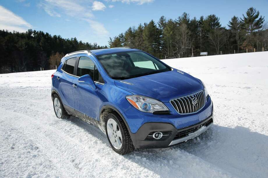 "2015 Buick EncoreMSRP: $24,065 | Autotrader noted the ""premium vibe"" created by this crossover's color schemes and build quality. It gets 33 miles per gallon on the highway. Photo: Buick / © 2015 General Motors. This image is protected by copyright but provided for use under a Creative Commons 3.0 License for the purpose of editorial comment only. The use of this image for advertising, marketing, or any other commercial purposes is prohibi"