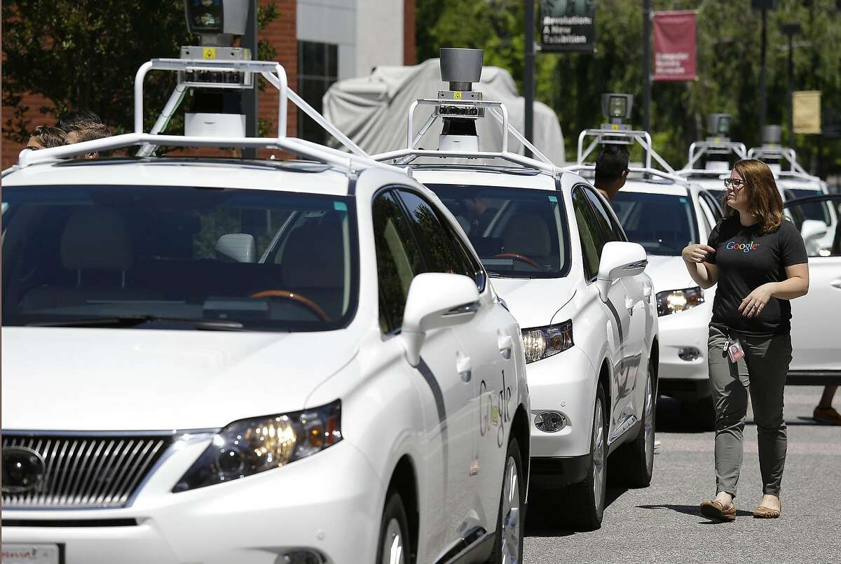 This May 13, 2014 file photo shows a row of Google self-driving Lexus cars at a Google event outside the Computer History Museum in Mountain View, Calif. Of the nearly 50 self-driving cars rolling around California roads and highways, four have gotten into accidents since September, 2014. That's when the state officially began permitting these cars of the future, which use sensors and computing power to maneuver around traffic. Three accidents involved Lexus SUVs run by Google Inc. The fourth was an Audi retrofitted by the parts supplier Delphi Automotive. Google and Delphi said the accidents were minor and their cars were not at fault.(AP Photo/Eric Risberg, File)