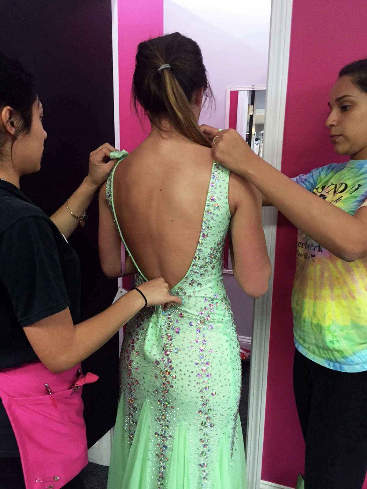 Kylee Opper has her prom dress altered to meet the dress code standard set by the Shelton, Conn. school system. Oppers mother, Trisha Marina, assumed this dress which was purchased after the first one was banned, would pass muster because only the back was exposed, not the front.