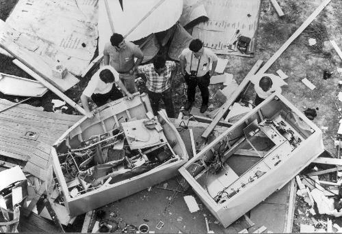 KPFT staffers inspect the remains of the station's transmitter after it was bombed. KFPT was bombed off the air twice in its first seven months of operations