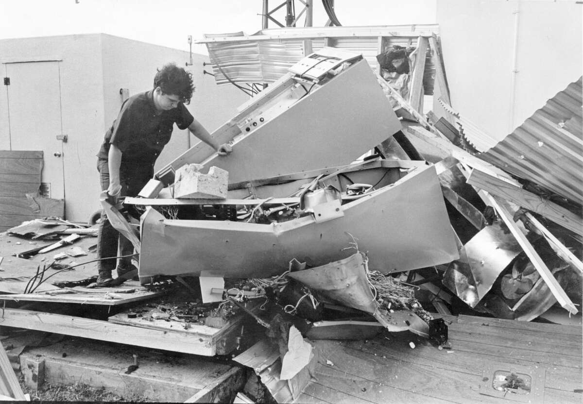 In this photo from May 1970, KPFT engineer William F. Miller sorts through the remains of a Pacifica Radio transmitter in Stafford destroyed by a dynamite blast - the second bombing in its first year.
