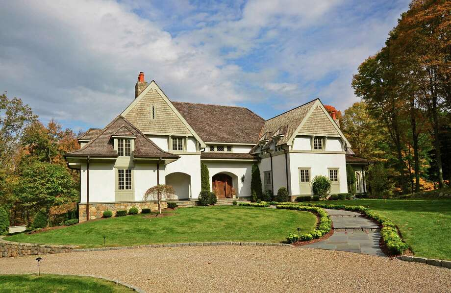 The stone and shingle English-country-inspired Colonial on Thayer Drive sits on more than two acres of property. Photo: Contributed Photo / New Canaan News