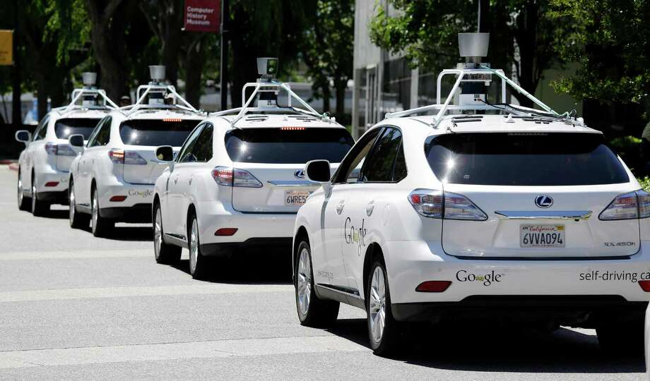 A row of self-driving Lexus cars at a Google event outside the Computer History Museum in Mountain View, Calif.  Photo: Eric Risberg, AP Photo / AP