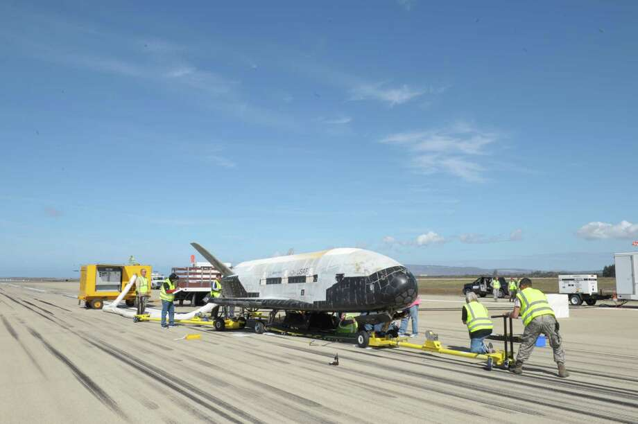 The X-37B Orbital Test Vehicle mission 3 (OTV-3), the Air Force's unmanned, reusable space plane, landed at Vandenberg Air Force Base at 9:24 a.m. Oct. 17, 2014. The OTV-3 conducted on-orbit experiments for 674 days during its mission, extending the total number of days spent on-orbit for the OTV program to 1367 days. The X-37B is the newest and most advanced re-entry spacecraft. Managed by the Air Force Rapid Capabilities Office, the X-37B program performs risk reduction, experimentation and concept of operations development for reusable space vehicle technologies. Photo: (Photo Credit: Boeing), Boeing