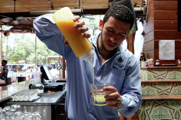 Fernando Echeverri, manager at La Tequilera del Patrón demonstrates how to make a margarita. The margarita at La Tequilera includes lime juice, orange juice, agave nectar, tequila, and orange liqueur.
