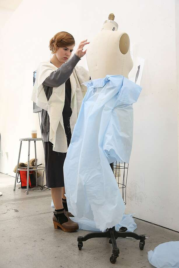 Junior design student Caitie Dodge at California College of the Arts works on her project in her sustainable fashion class. She is experimenting with shapes as she works on women sportswear using minimal waste and minimal dye. Photo: Liz Hafalia, The Chronicle