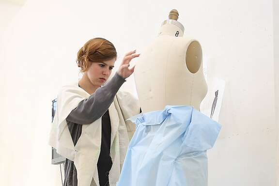 Junior design student Caitie Dodge  at California College of the Arts works on her project in her sustainable fashion class in San Francisco, California, on Friday, May 8, 2015.  She is experimenting with shapes as she works on women sportswear using minimal waste and minimal dye.