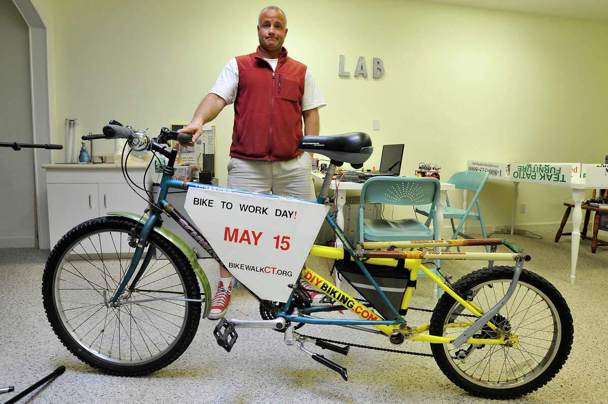 John Robert, with Rippowam Labs, shows off a bike he takes to work from time to time at his workplace on Summer Street in downtown Stamford, Conn., on Monday, May 11, 2015. The custom-made bicycle was made by a friend of his and made out of an assortment of spare bike parts.