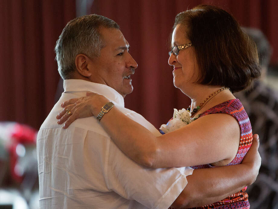 Ernest Flores, left, dances with his wife of 35 years, Ernestina Flores, right, during the District I Senior Citizens Prom held at Brady's Landing, Monday, May 11, 2015, in Houston. Houston Council Member Robert Gallegos hosted the first annual event to more than 300 senior citizens. Photo: Cody Duty, Houston Chronicle / © 2015 Houston Chronicle