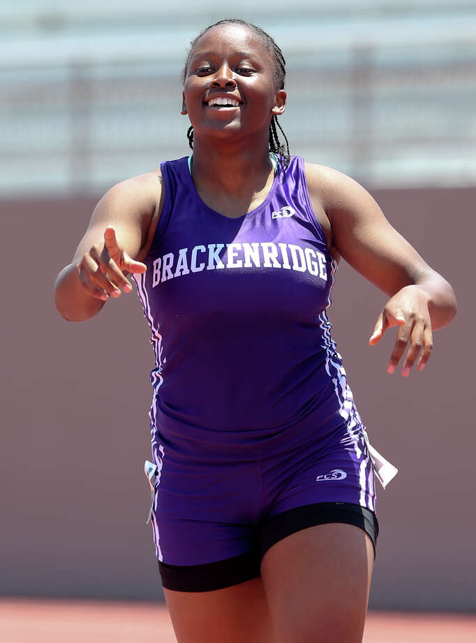 Brackenridge's Tevis Thomas reacts after winning the 5A 100-meter dash  during the Region IV-5A and Region IV-6A Track and Field meet at Alamo Stadium on Saturday, May 2, 2015.  Thomas won the event with a time of 12.16 seconds. She also qualified for the upcoming State meet with a second place finish in the 200-meter dash.  MARVIN PFEIFFER/ mpfeiffer@express-news.net Photo: Marvin Pfeiffer, Staff / San Antonio Express-News / Express-News 2015