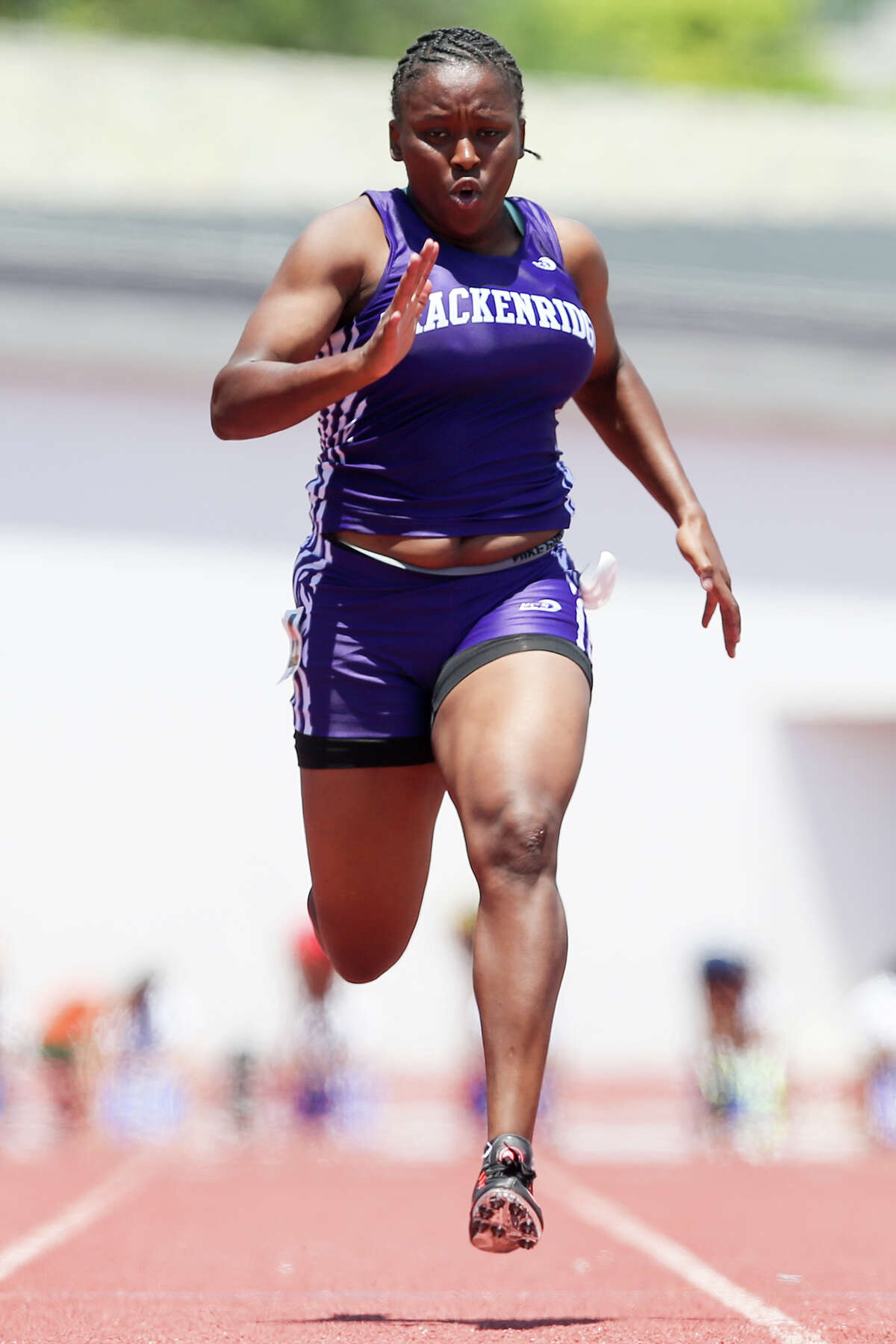 Brackenridge's Tevis Thomas approaches the finish line of the 5A 100-meter dash during the Region IV-5A and Region IV-6A Track and Field meet at Alamo Stadium on Saturday, May 2, 2015. Thomas won the event with a time of 12.16 seconds. She also took second in the 200-meter dash with a time of 24.99 seconds. MARVIN PFEIFFER/ mpfeiffer@express-news.net