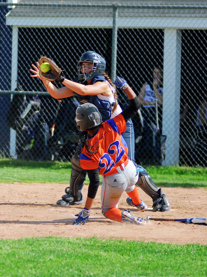 Danbury's Davonna Spruill (22) slides in safe ahead of Staples' Catcher Nicola Schenck during a game on Monday. Danbury won 10-1 for its fifth straight win. Photo: Ryan Lacey/Staff Photo / Westport News Contributed