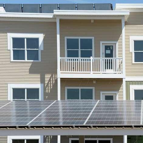 Solar thermal panels atop an apartment building and car port, bottom, at netZero village Friday May 8, 2015 in Rotterdam, NY. (John Carl D'Annibale / Times Union) Photo: John Carl D'Annibale / 00031774A