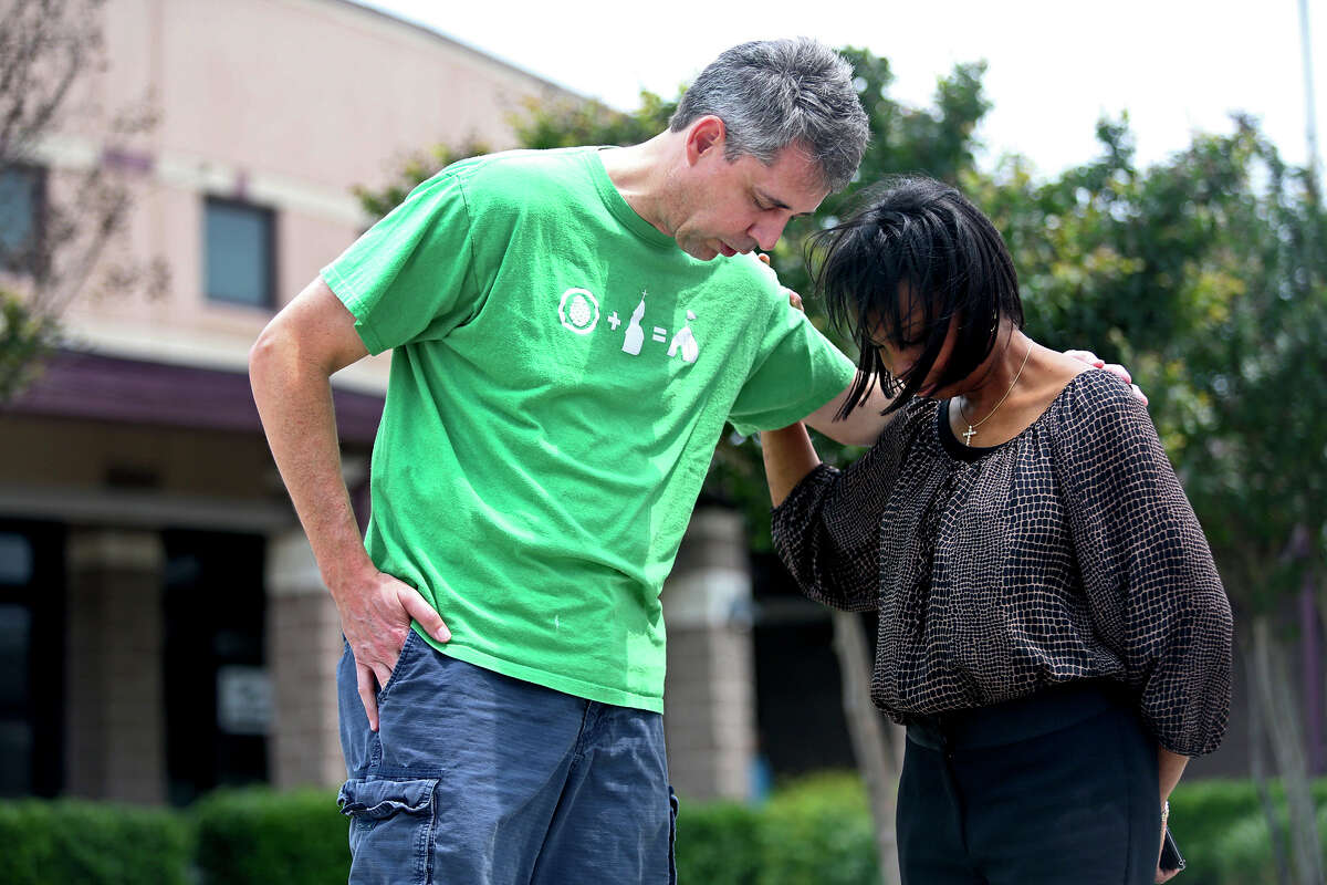 Roger Poupart, Senior Pastor at Wayside Chapel, prays with Mayor Ivy Taylor after he voted at Huebner Elementary School. Taylor greeted voters upon their arrival at the school to vote as she campaigned to keep her position as mayor on election day in San Antonio on Saturday, May 9, 2015.
