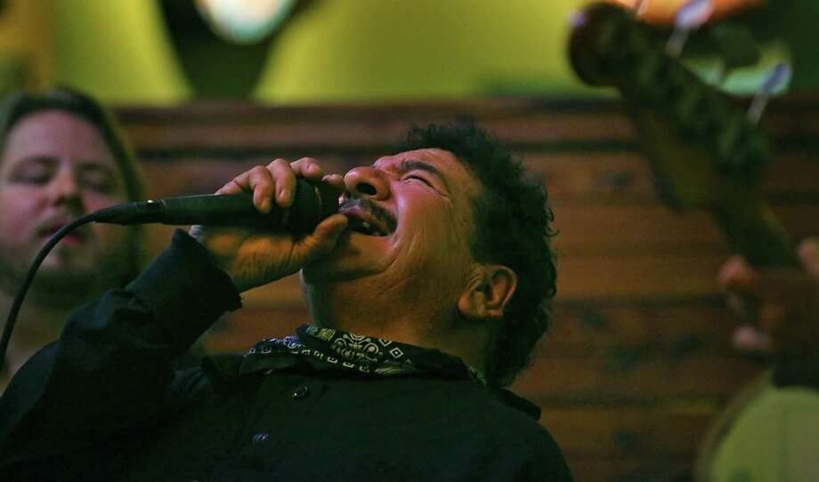 Little Roger Gonzalez sings with The Will Owen Gage Trio at Barriba Cantina on the Riverwalk.  Gonzalez was the vocalist for S.A.'s Rhythm Kings back in the day. Thursday, Jan. 22, 2015. Photo: Bob Owen, Staff / San Antonio Express-News / © 2015 San Antonio Express-News
