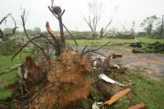 Downed tree and debris from Van, Texas is scattered around the town Monday, May 11, 2015, after severe weather pushed through the area in the early morning hours. Emergency responders searched through splintered wreckage Monday after a line of tornadoes battered several small communities in Texas and Arkansas, killing at least five people. (AP Photos/Todd Yates) ORG XMIT: TXTY108 Photo: Todd Yates / FR107466 AP