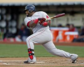 Boston Red Sox' Pablo Sandoval grounds into a double play during 2nd inning at bat against Oakland Athletics during MLB game at O.co Coliseum in Oakland, Calif., on Monday, May 11, 2015.