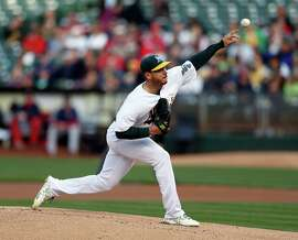 Oakland Athletics' Scott Kazmir pitches to Boston Red Sox in 1st inning during MLB game at O.co Coliseum in Oakland, Calif., on Monday, May 11, 2015.