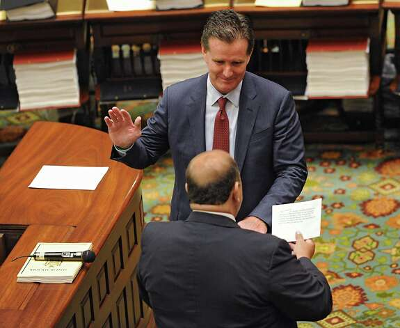 Senate Secretary Frank Patience administers the oath of office to Senator John Flanagan as the new Senate Majority Leader in the Senate Chamber at the Capitol on Monday, May 11, 2015 in Albany, N.Y. (Lori Van Buren / Times Union) Photo: Lori Van Buren