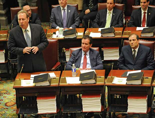 Senator Joseph Robach, left, speaks in support of Senator John Flanagan, center, before a vote on a new Senate Majority Leader in the Senate Chamber at the Capitol on Monday, May 11, 2015 in Albany, N.Y. Senator Andrew Lanza sits on right. (Lori Van Buren / Times Union) Photo: Lori Van Buren