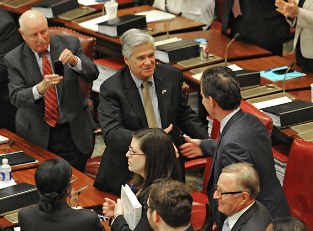Senator Dean Skelos, center, congratulates Senator John Flanagan, right, after Flanagan received the oath of office to be the new Senate Majority Leader in the Senate Chamber at the Capitol on Monday, May 11, 2015 in Albany, N.Y. Senator Kenneth LaValle, left, takes a photo with his phone. (Lori Van Buren / Times Union) Photo: Lori Van Buren