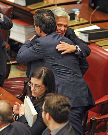 Senator Dean Skelos congratulates Senator John Flanagan, right, after Flanagan received the oath of office to be the new Senate Majority Leader in the Senate Chamber at the Capitol on Monday, May 11, 2015 in Albany, N.Y.  (Lori Van Buren / Times Union) Photo: Lori Van Buren