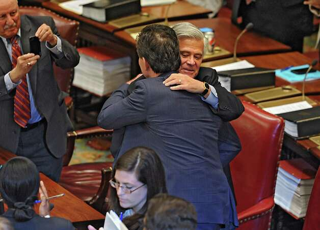 Senator Dean Skelos congratulates Senator John Flanagan, right, after Flanagan received the oath of office to be the new Senate Majority Leader in the Senate Chamber at the Capitol on Monday, May 11, 2015 in Albany, N.Y. Senator Kenneth LaValle, left, takes a photo with his phone. (Lori Van Buren / Times Union) Photo: Lori Van Buren