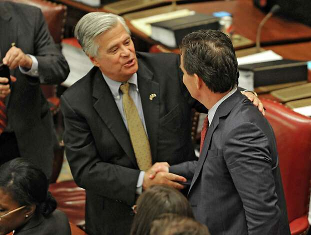 Senator Dean Skelos, left, congratulates Senator John Flanagan after Flanagan received the oath of office to be the new Senate Majority Leader in the Senate Chamber at the Capitol on Monday, May 11, 2015 in Albany, N.Y. (Lori Van Buren / Times Union) Photo: Lori Van Buren
