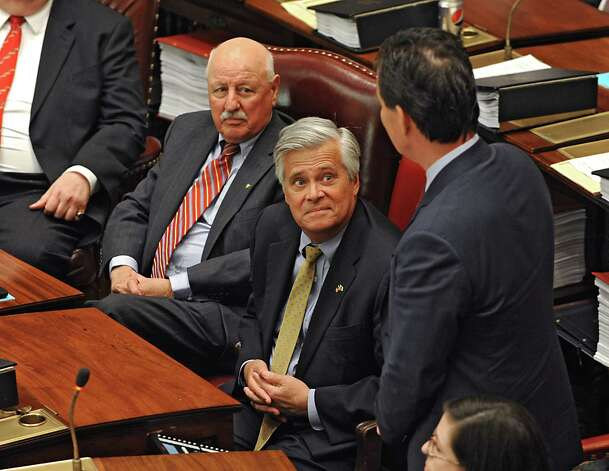 Senator John Flanagan, right, thanks Senator Dean Skelos, center, for all he's done as Senate Majority Leader after Flanagan received the oath of office to be the new Senate Majority Leader in the Senate Chamber at the Capitol on Monday, May 11, 2015 in Albany, N.Y. Senator Kenneth LaValle listens at left. (Lori Van Buren / Times Union) Photo: Lori Van Buren
