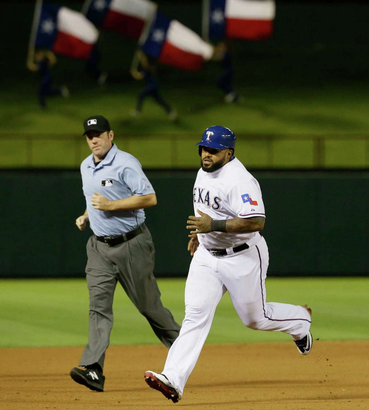 Rangers designated hitter Prince Fielder rounds the bases after hitting a solo home run during the eighth inning. Fielder, who missed almost all of last season after neck surgery, hit his third homer of the season.