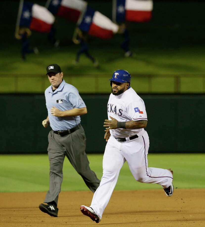 Rangers designated hitter Prince Fielder rounds the bases after hitting a solo home run during the eighth inning. Fielder, who missed almost all of last season after neck surgery, hit his third homer of the season. Photo: LM Otero /Associated Press / AP