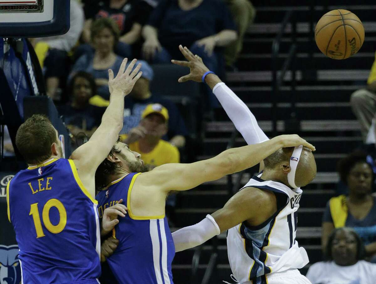 Golden State Warriors center Andrew Bogut (12) makes contact after blocking a shot by Memphis Grizzlies guard Vince Carter (15) in the first half of Game 4 of a second-round NBA basketball Western Conference playoff series, Monday, May 11, 2015, in Memphis, Tenn.