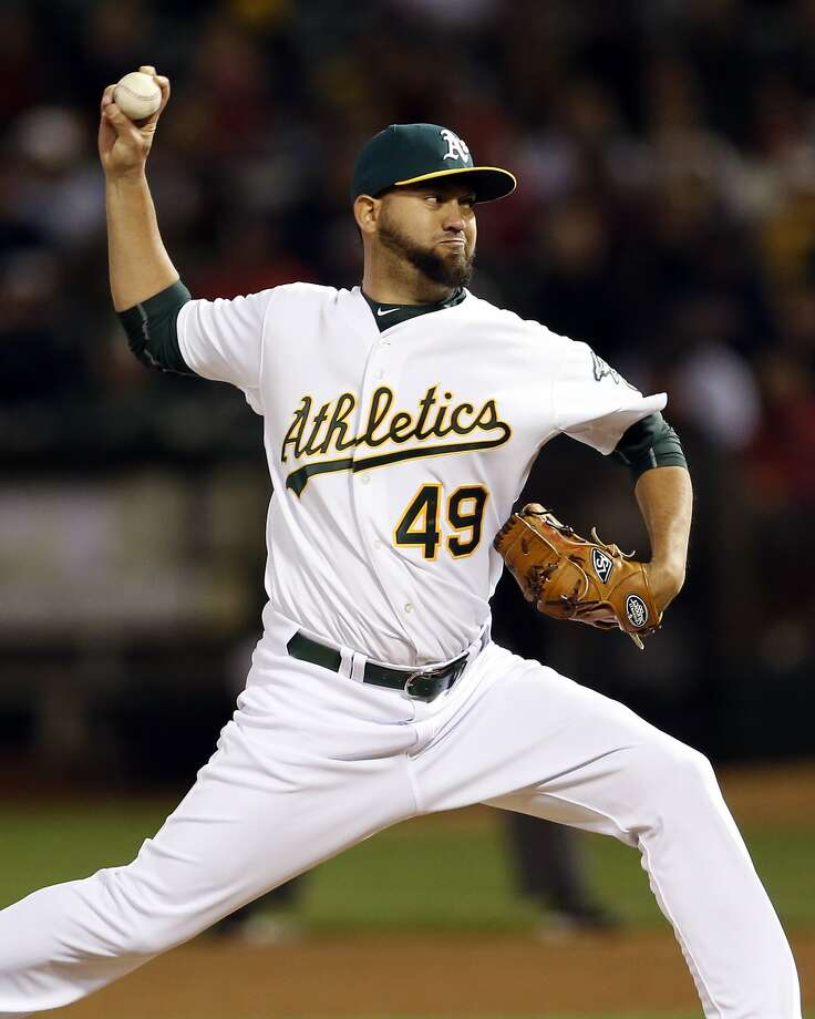 Oakland Athletics' Edward Mujica pitches in 8th inning against Boston Red Sox during MLB game at O.co Coliseum in Oakland, Calif., on Monday, May 11, 2015. Photo: Scott Strazzante, The Chronicle