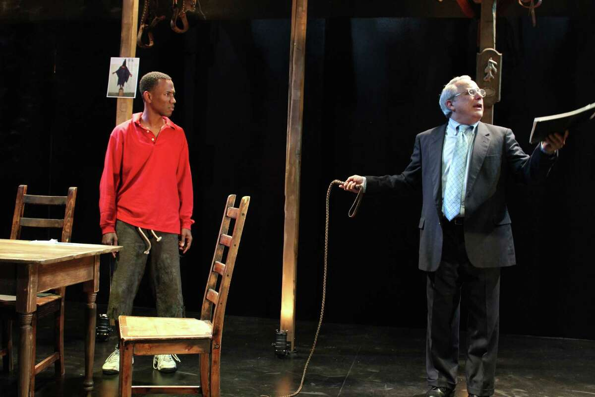 Donald Rumsfeld (David Sinaiko, right) defends his use of enhanced interrogation to Frederick Douglass (Giovanni Adams) in Cutting Ball's world premiere of