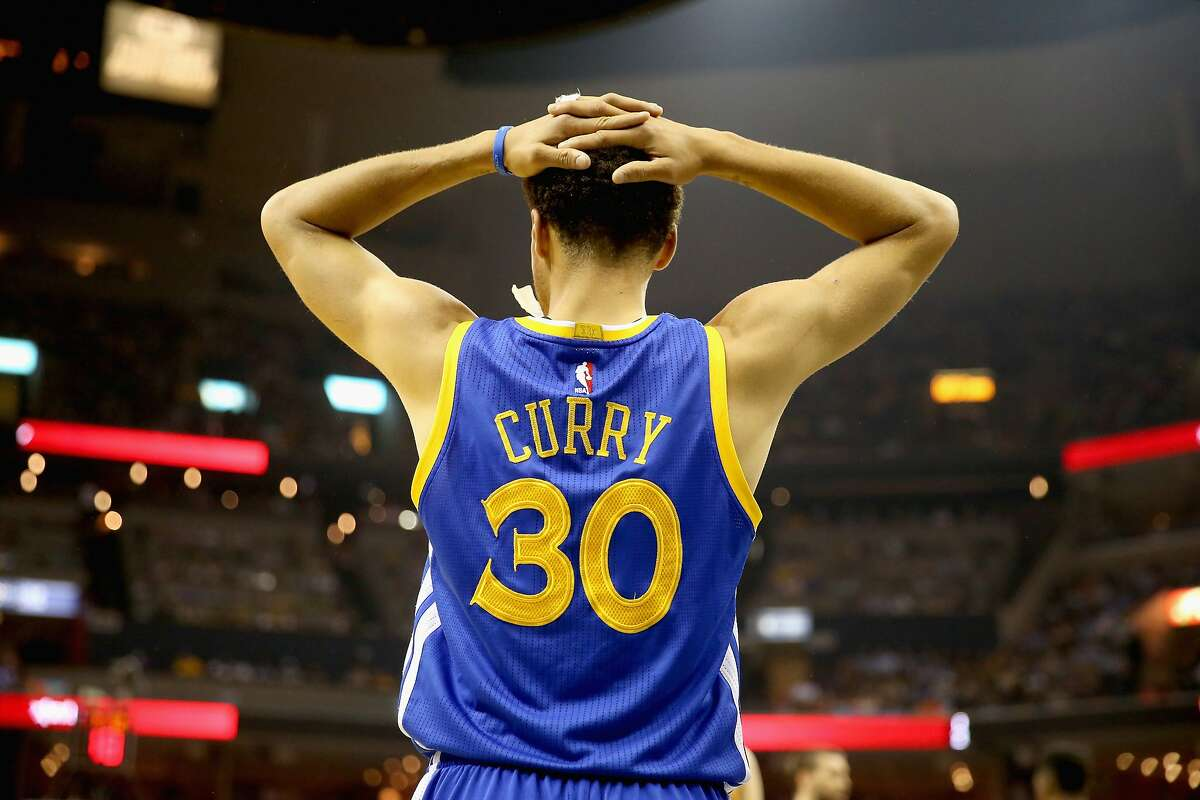 Stephen Curry of the Golden State Warriors watches the action against the Memphis Grizzlies during Game four of the Western Conference Semifinals of the 2015 NBA Playoffs at FedExForum on May 11, 2015 in Memphis, Tennessee.