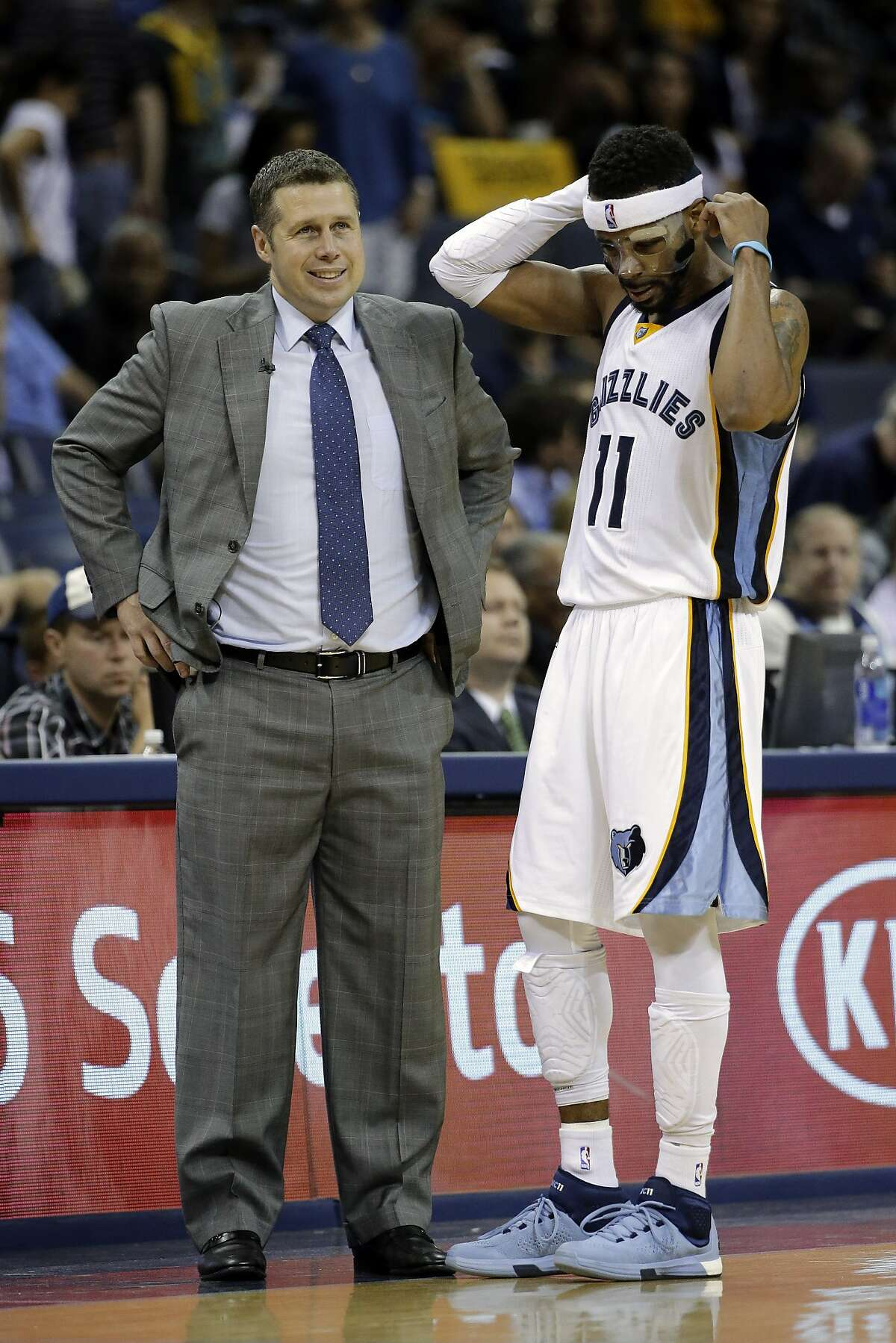 Memphis Grizzlies head coach David Joerger talks with guard Mike Conley (11) in the second half of Game 4 of a second-round NBA basketball Western Conference playoff series against the Golden State Warriors Monday, May 11, 2015, in Memphis, Tenn.