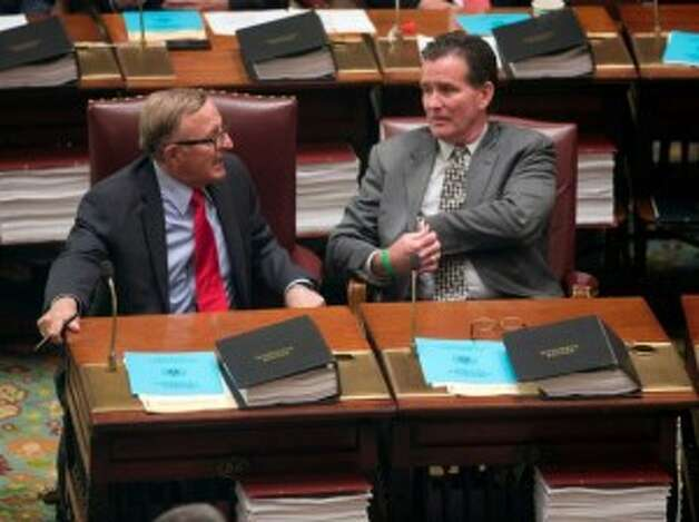 New Senate Majority Leader John Flanagan, right, sits with Sen. John DeFrancisco, the man he defeated to lead the chamber in the wake for former Majority Leader Dean Skelos' arrest on federal charges. (Lori Van Buren / Times Union)