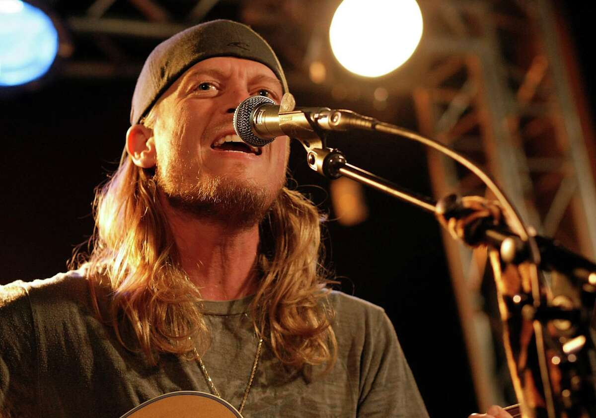 FILE - This Dec. 7, 2009 file photo shows Wes Scantlin of the band Puddle of Mudd performing at the Gibson Guitar Dusk Tiger launch party in Beverly Hills, Calif. Scantlin has missed a court date after being arrested for riding the oversized luggage carousel at the Denver International Airport last month. Scantlin was arrested by Denver police and charged with misdemeanor trespassing after taking his joy ride into an area that requires a security clearance for entrance.